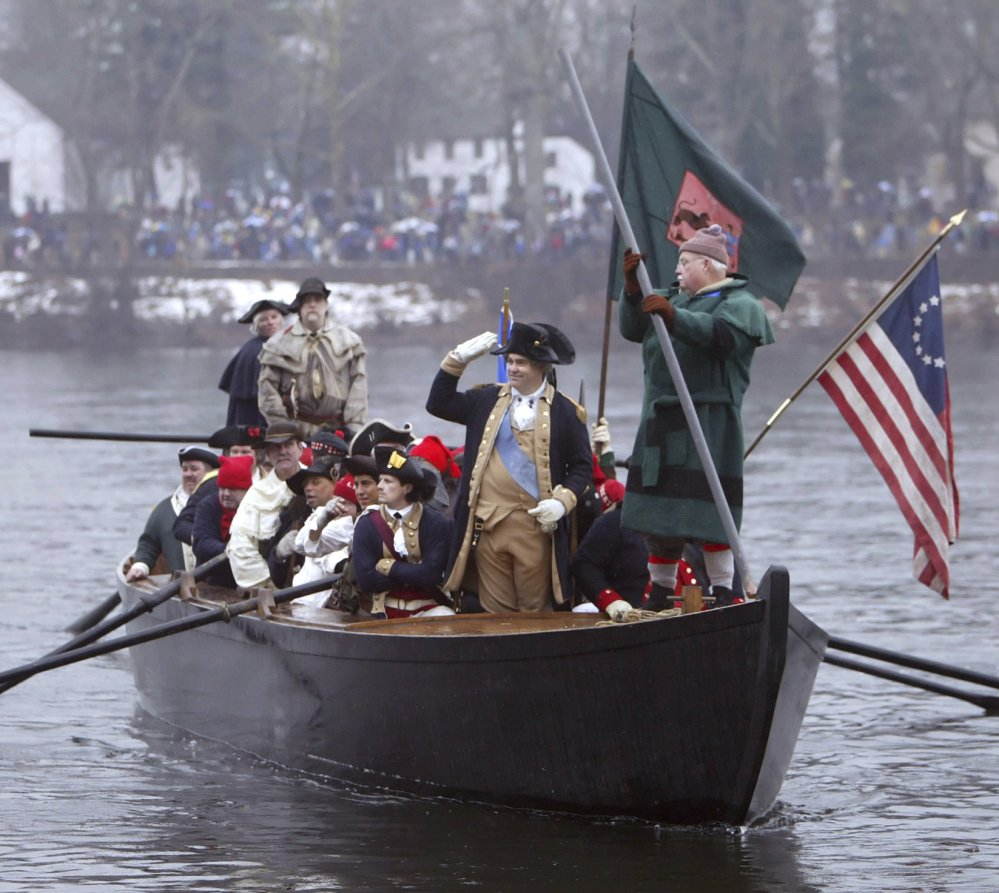 Re-enactor James Gibson waves to spectators as he portrays Gen. George Washington during the 53rd annual Christmas Day crossing of the Delaware River in 2005.