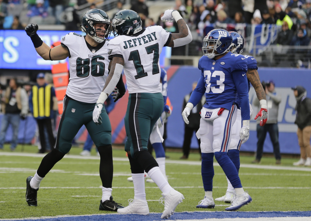 Eagles tight end Zach Ertz, left, celebrates a touchdown catch with wide receiver Alshon Jeffery during a 34-29 win Sunday against the New York Giants.