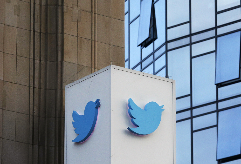 A Twitter sign standing outside of the company's headquarters in San Francisco. Twitter will be enforcing stricter policies on violent and abusive content such as hateful images or symbols, including those attached to user profiles, the company announced Monday.