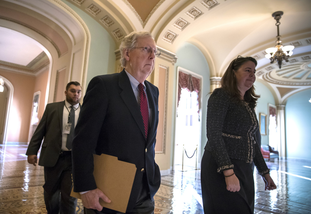 Senate Majority Leader Mitch McConnell, R-Ky., walks to the Senate chamber Monday as Republicans in Congress prepare to pass their $1.5 trillion tax bill on party-line votes this week. The House is likely to vote Tuesday and the Senate either Tuesday or Wednesday.