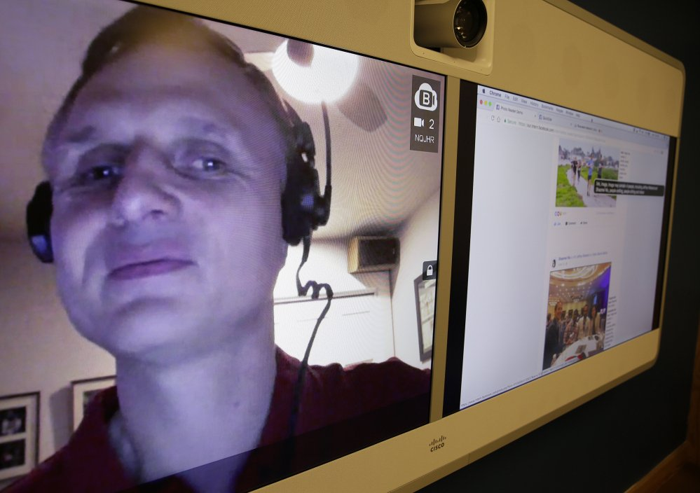Engineer Matt King, who is blind, demonstrates facial recognition technology Tuesday via a teleconference at Facebook headquarters in Menlo Park, Calif.