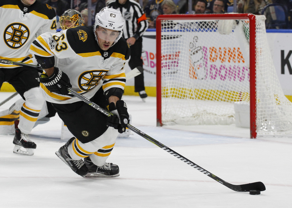 Boston forward Brad Marchand (63) controls the puck during the first period. Associated Press/Jeffrey T. Barnes