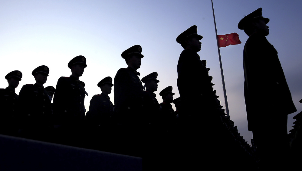Chinese paramilitary police stand at attention during a ceremony earlier this month. U.S. officials are growing concerned about China's growth in military spending.