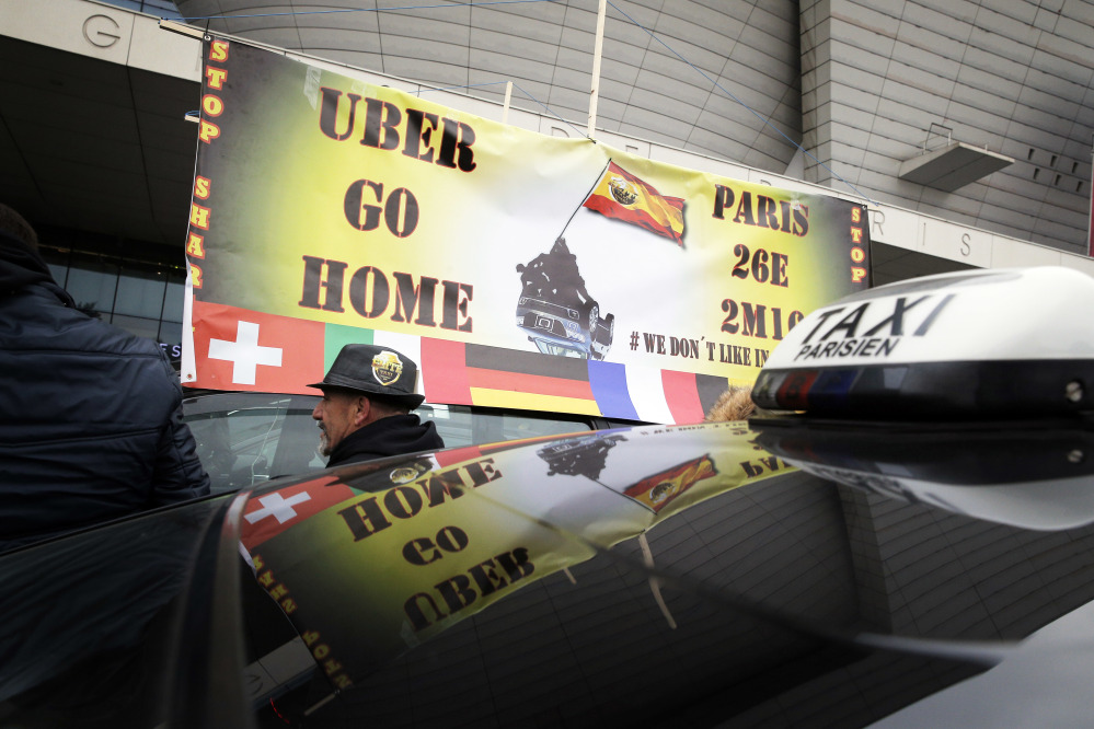 Taxi drivers demonstrate in Paris in 2016. Cab drivers in Barcelona honked their horns in victory Wednesday after the EU's top court ruled Uber can be regulated like a taxi company.