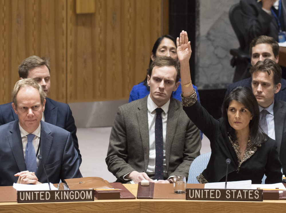 U.S. Ambassador to the United Nations Nikki Haley, right,  told U.N. members Wednesday that President Trump will be keeping track of those who vote against the U.S.