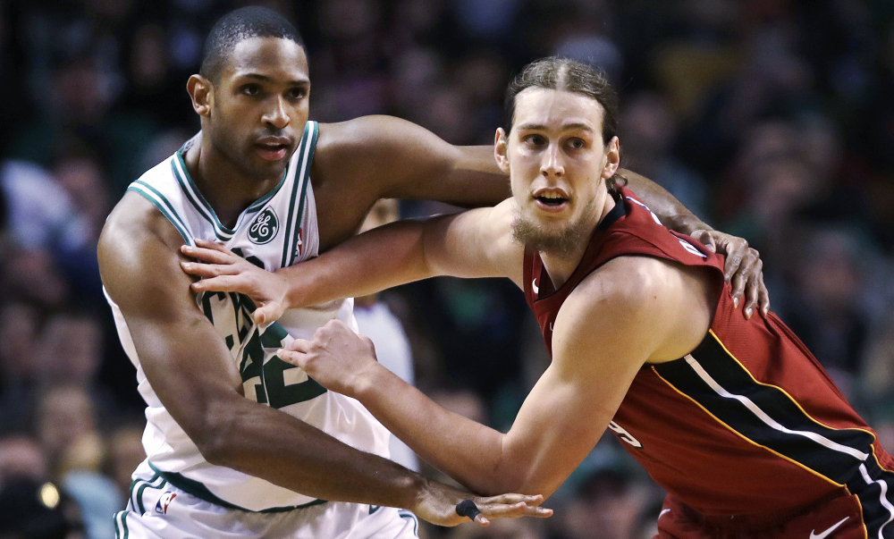 Kelly Olynyk pushes off Celtics forward Al Horford while trying to receive a pass in the first quarter.