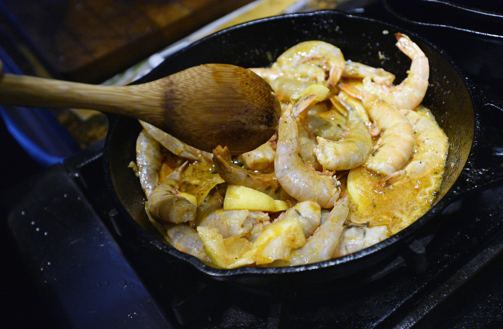 Louisiana BBQ shrimp with butter, garlic, lemon and three types of pepper.