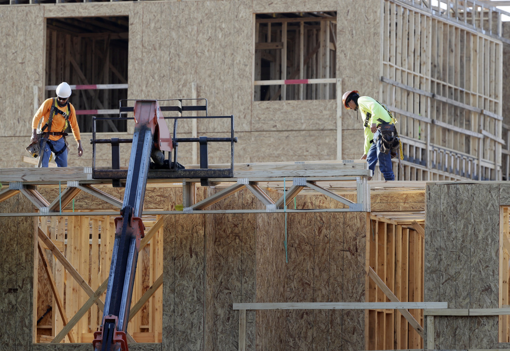 Construction workers build a residential complex in Nashville, Tenn. The U.S. economy grew at a 3.2 percent annual rate from July through September.