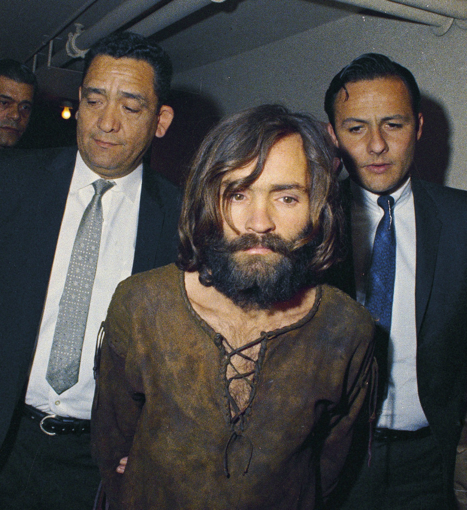 Charles Manson is escorted to his arraignment in 1969on conspiracy-murder charges .
