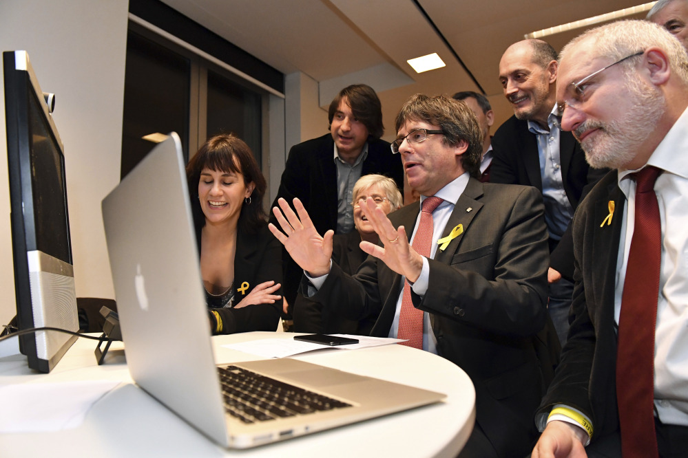 Ousted Catalan leader Carles Puigdemont watches election results for Spain's Catalonia region at the Square Meeting Center in Brussels, Belgium, on Thursday. Several members of the ousted Cabinet, including Puigdemont, have campaigned from Brussels, where they sought refuge from Spanish justice.