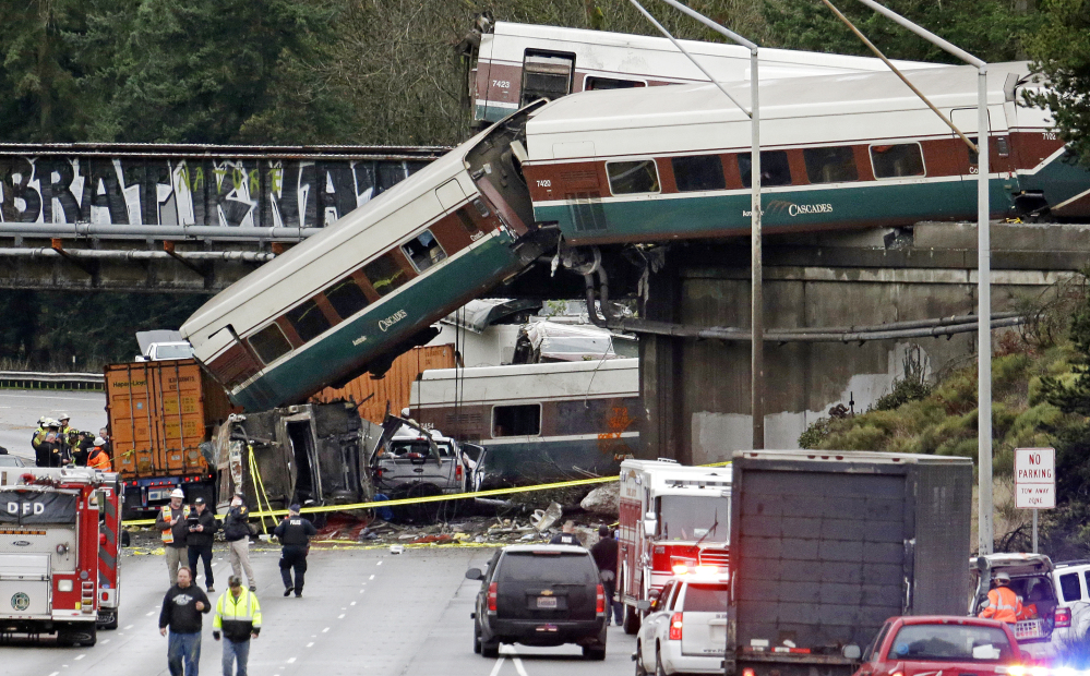 Cars from an Amtrak train lie spilled onto Interstate 5 alongside smashed vehicles in DuPont, Wash., on Monday.
