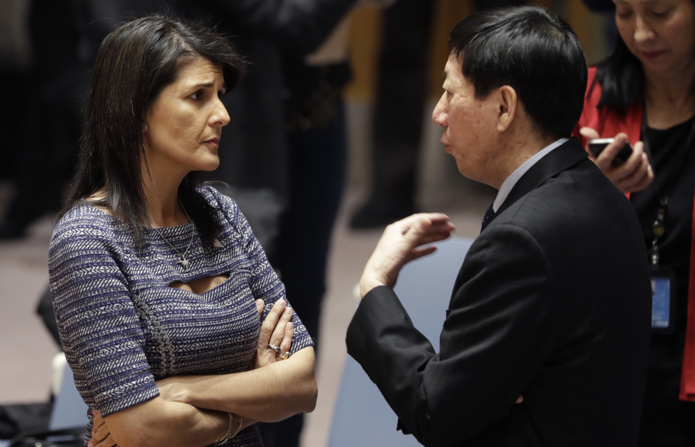 U.S. Ambassador to the United Nations Nikki Haley speaks with Chinese deputy ambassador Wu Haitao on Friday as delegates prepare to vote on sanctions against North Korea.
