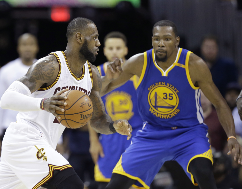 LeBron James, left, and Kevin Durant will be spending Christmas together again, still rivals, as the Cleveland Cavaliers visit the Golden State Warriors.