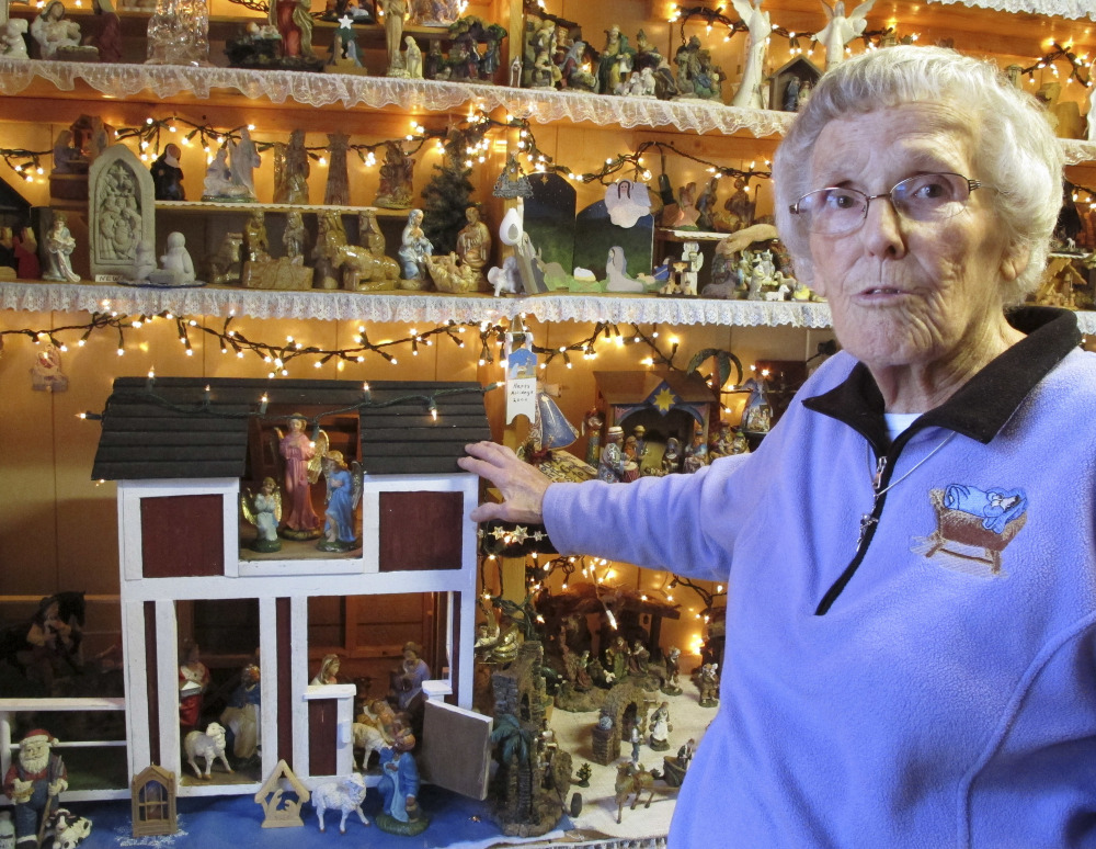Shirley Squires, 87, of Guilford, Vt., shows off nativity scenes on display at her home. Many are crafted from wood, porcelain, plastic or clay.