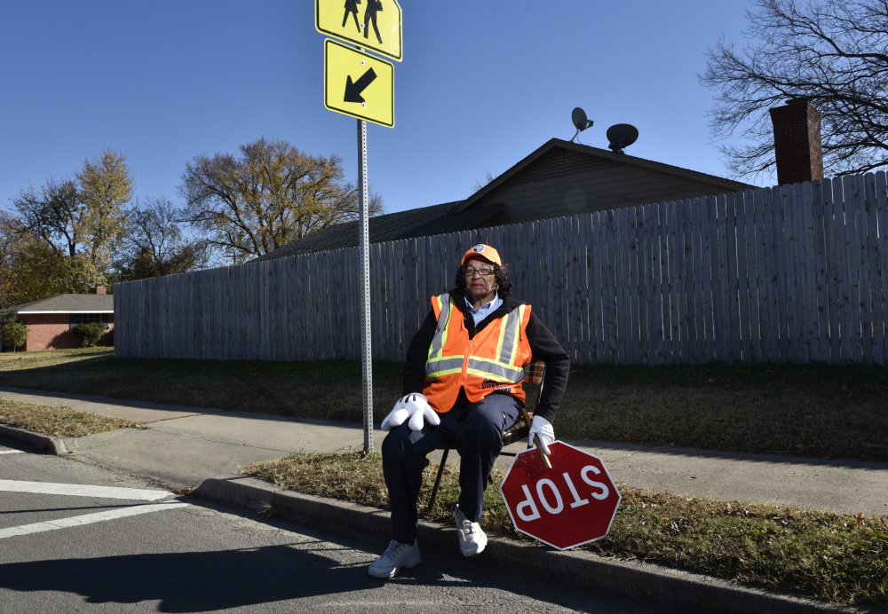 "Former McDonnell-Douglas employee Ruby Oakley, 74, works as a crossing guard in Tulsa, Okla. Another worker stranded after the airplane maker closed its Tulsa plant became a barber, saying, ""Thank God I had a couple of clippers."" Now a federal report warns a retirement crisis could be looming, as many older Americans have to work in order to keep afloat."