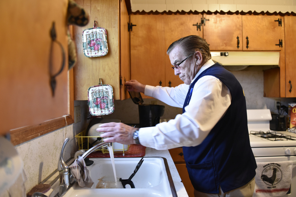 Former McDonnell-Douglas worker Tom Coomer, 79, makes coffee at home in Wagoner, Okla., after his workday at Walmart.
