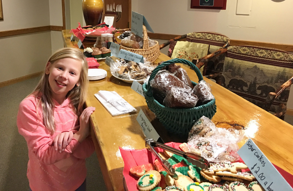 "Lucy Kenney gave $100 from her bake sale to the Toy Fund after realizing some people can't afford toys. ""It took a week for me and my mom to make all the treats,"" she says."