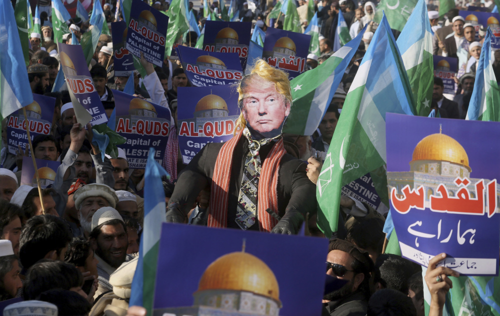 Supporters of Jamaat-e-Islami take part in an anti-American rally to condemn President Trump for declaring Jerusalem as Israel's capital, in Peshawar, Pakistan, on Friday.