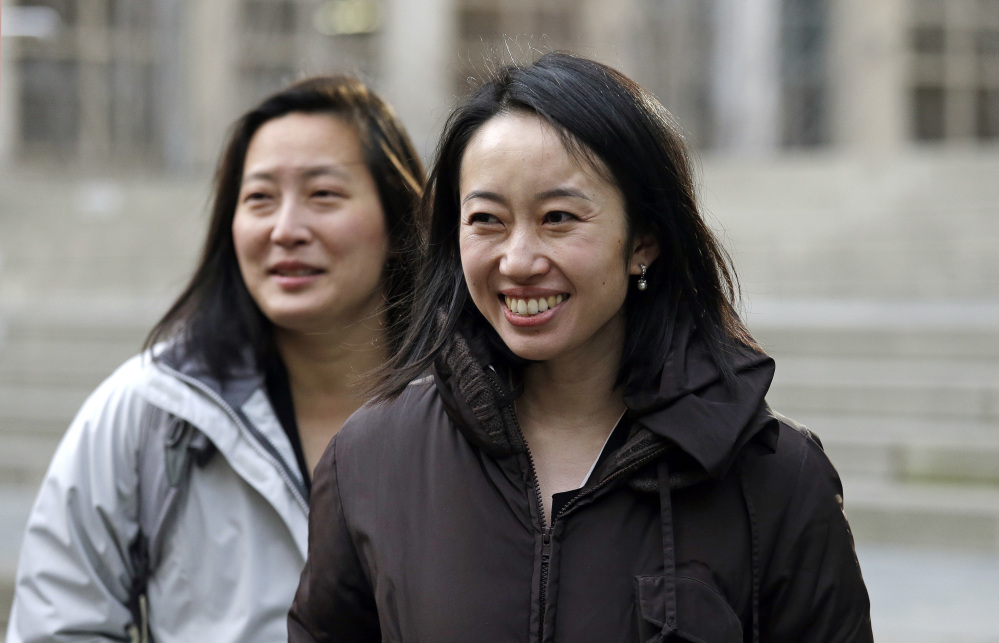 Mariko Hirose, right, a lawyer on the Jewish Family Service case and litigation director for the International Refugee Assistance Project, and Esther Sung, a staff attorney at the National Immigration Law Center,  leave the federal courthouse in Seattle after speaking with media members.