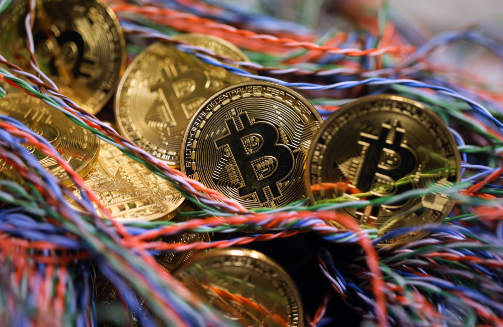 Bitcoins sit among twisted copper wiring inside a communications room at an office in London in September.