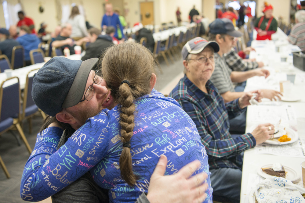 Madison Rowe, 13, gives her father, James Rowe, a hug after a turkey dinner Monday at the Elks Lodge in Waterville.