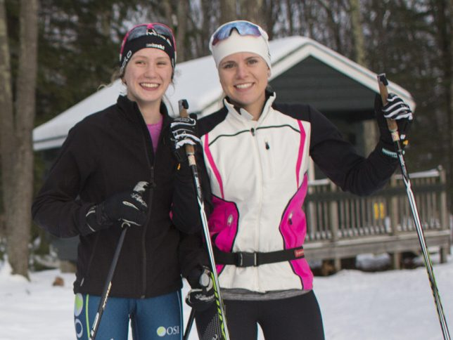 Skiers Olivia Skillings, left, of Maine Coast Waldorf and Sophia Laukli of Yarmouth are close friends who will compete against each other.