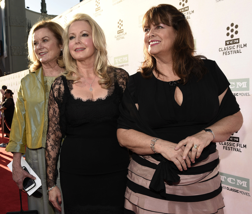 Heather Menzies-Urich, left, Kym Karath and Debbie Turner, right, cast members in the classic film
