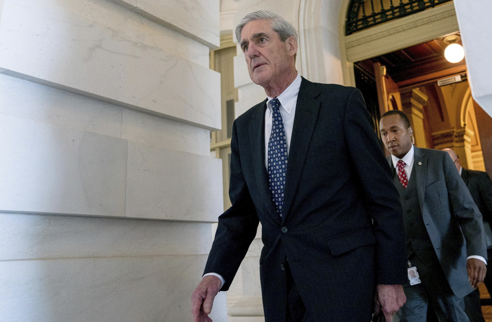 FILE - In this June 21, 2017, file photo, former FBI Director Robert Mueller, the special counsel probing Russian interference in the 2016 election, departs Capitol Hill in Washington. President Donald Trump's transition organization is arguing that a government agency improperly turned over a cache of emails to Mueller as part of his investigation into contacts between Trump associates and Russia. The complaint by the transition team is the latest attempt to undermine Mueller's investigation in the public sphere. (AP Photo