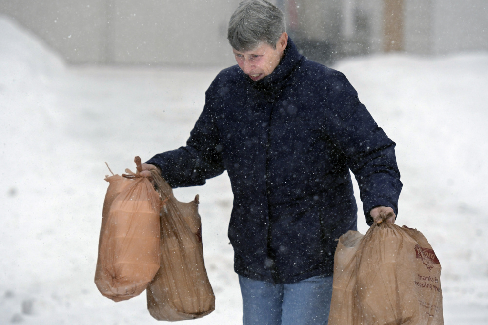 Patty Prescott delivers some of the 250 meals served Monday by the Emmanuel Lutheran Episcopal Church in Augusta.