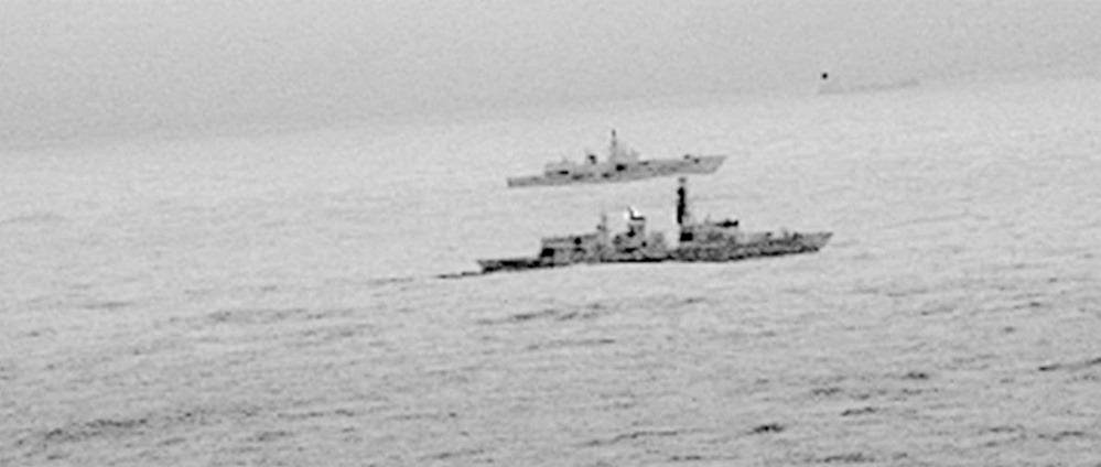 "Royal Navy frigate HMS St Albans escorts a Russian warship through what Britain calls ""areas of national interest"" amid increasing tensions between the two countries."