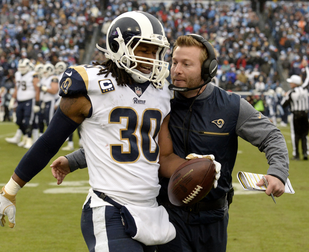 Los Angeles Rams RB Todd Gurley gets a pat on the back from Coach Sean McVay on Sunday. McVay's team has relied on Gurley for 38 percent of its yards from scrimmage.