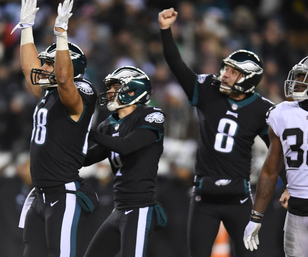 Eagles kicker Jake Elliott, center, watches his go-ahead field goal as tight end Trey Burton, left, and punter Donnie Jones celebrate during the fourth quarter of Philadelphia's 19-10 win over Oakland on Monday.