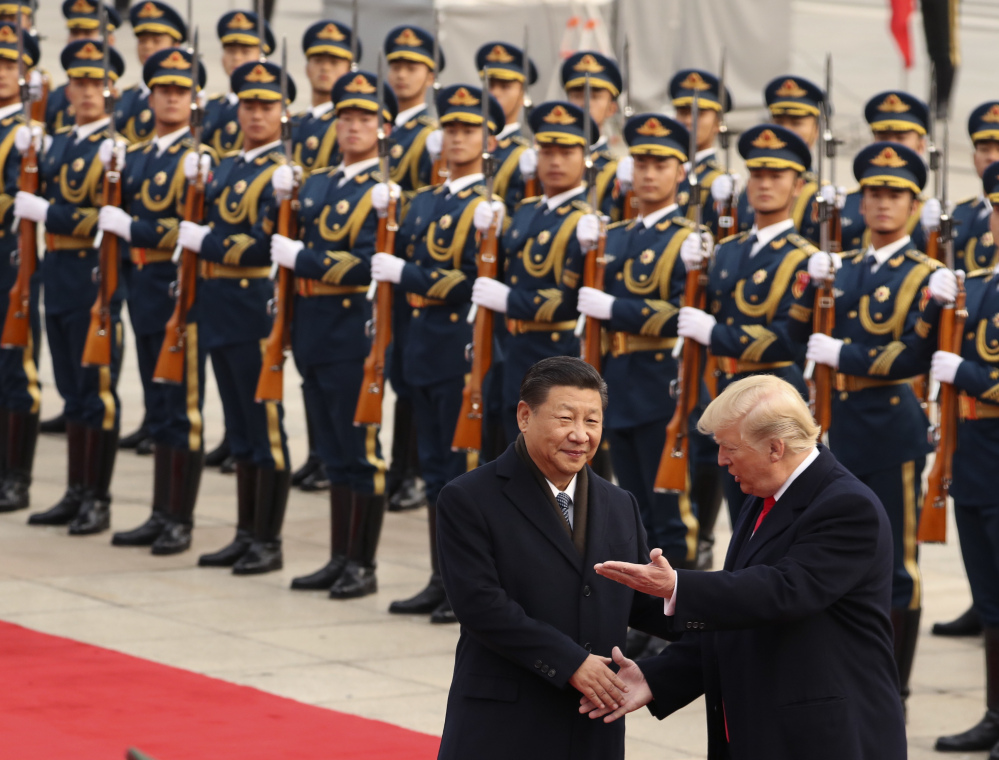 President Trump and Chinese President Xi Jinping participate in a welcome ceremony at the Great Hall of the People in Beijing on Nov. 9. Trump is ending his first year in office without welcoming a counterpart to visit the U.S.