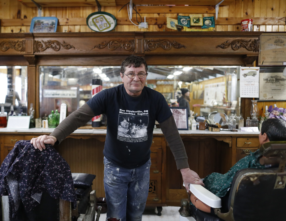 A 20-year resident of New Straitsville, Ohio, Tom Craig stands among the vestiges of the local barbershop, complete with original barber's chairs and mirrors. The space is now a museum, in line with the region's effort to promote Appalachia as a chic area with down-home charm and ample outdoor recreation.
