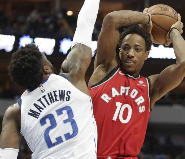 DeMar DeRozan of the Toronto Raptors looks for a way around Wesley Matthews of the Dallas Mavericks. Dallas won, 98-93.