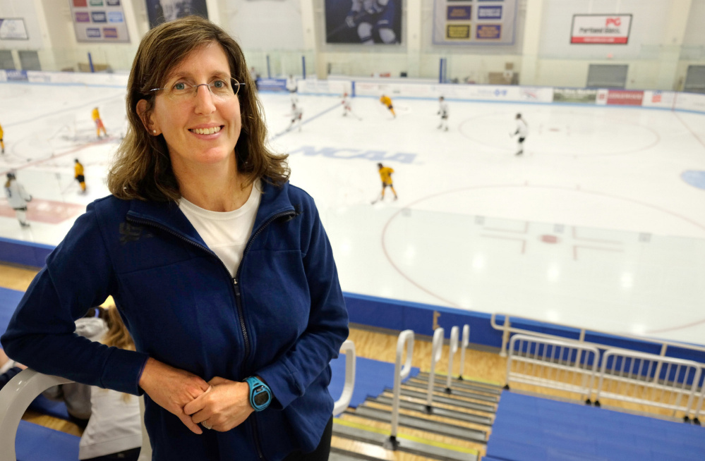 "In her eighth year of involvement with USA Hockey, Dr. Allyson Howe of Portland will be traveling to South Korea in the coming weeks as head physician for the USA women's ice hockey team in the 2018 Winter Olympics. Pictured here near the ice arena at the University of New England in Biddeford, Howe said: ""I feel really lucky."""