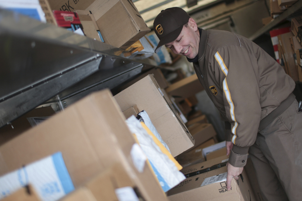 Branden Holverson poses inside a UPS truck in Idaho Falls, Idaho, in December. The on-time delivery rate for both UPS and FedEx was in the high 90s, percentage wise. At least some UPS employees worked on Sunday to deliver an estimated 750 million packages.