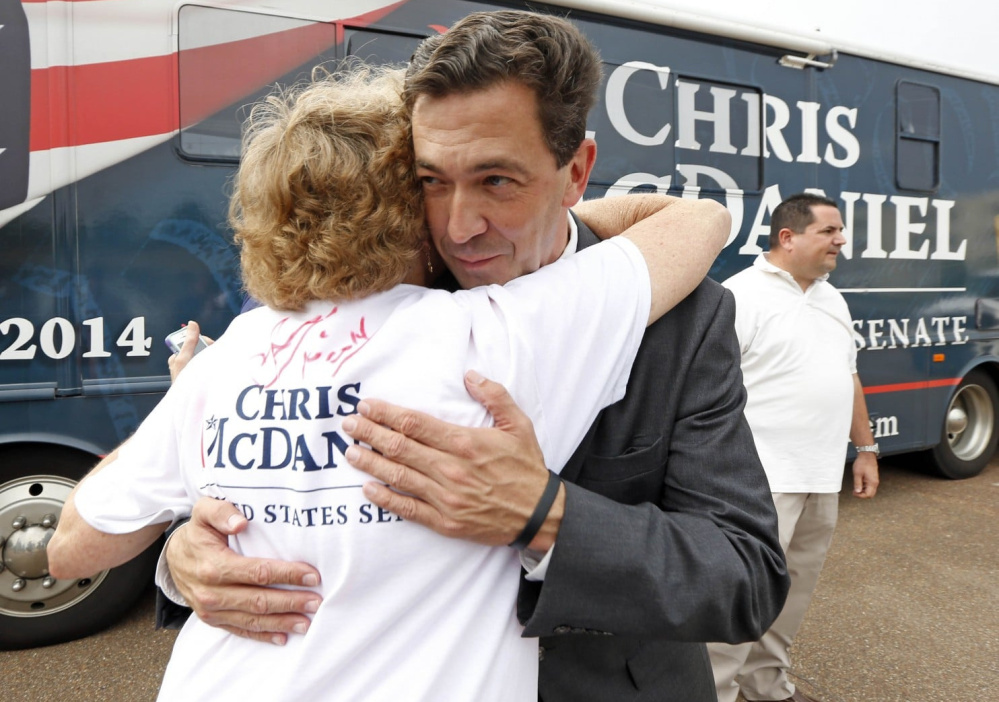 Mississippi state Sen. Chris McDaniel hugs a supporter during a 2014 U.S. Senate bid. As the Republican plans a new run, he may battle the party favorites and President Trump.