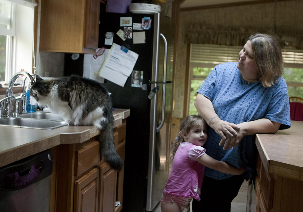Wendy Brennan, seen with granddaughter Madelyn Begin at her Mount Vernon home in 2014, had a filter installed on her tap after she learned that her drinking water contained arsenic. More than half of Maine's wells have not been tested for the toxic element.