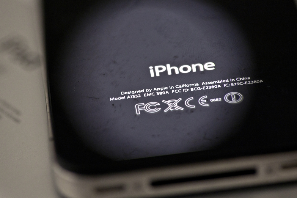 Apple is apologizing for secretly slowing down older iPhones, like the one pictured in this file photograph.