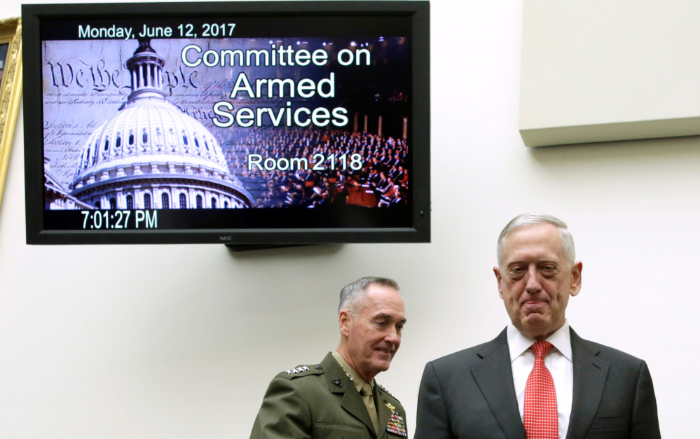 Defense Secretary James Mattis, right, and Joint Chiefs Chairman Gen. Joseph Dunford arrive for a House hearing in June. It is high time to find alternatives to trying to control international events through military means, the writer says.