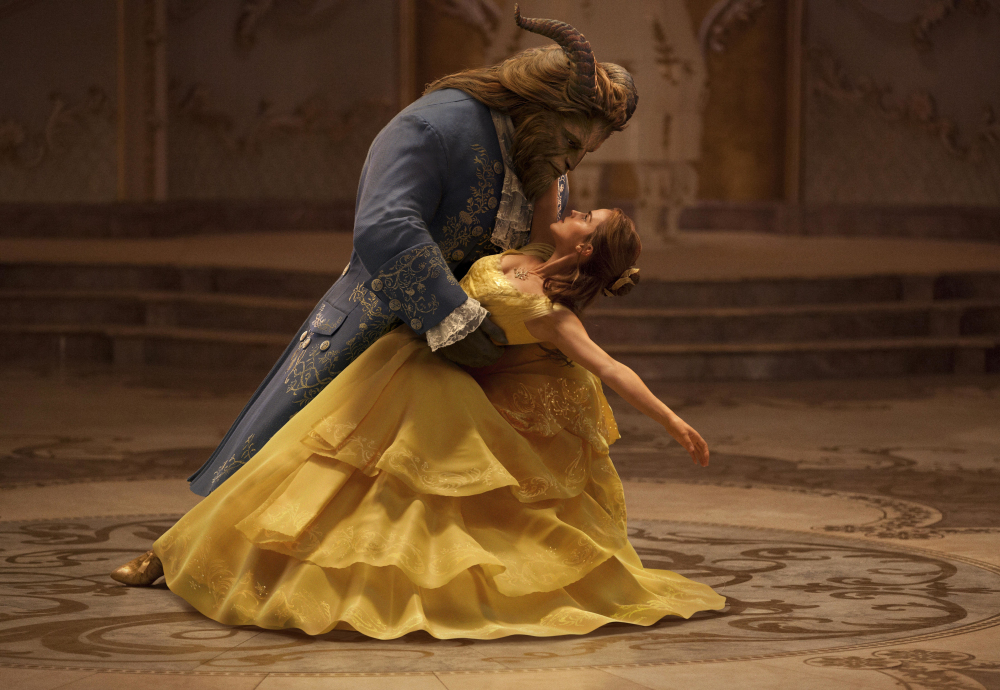 Dan Stevens is The Beast, left, and Emma Watson plays Belle in Disney's live-action adaptation of the classic