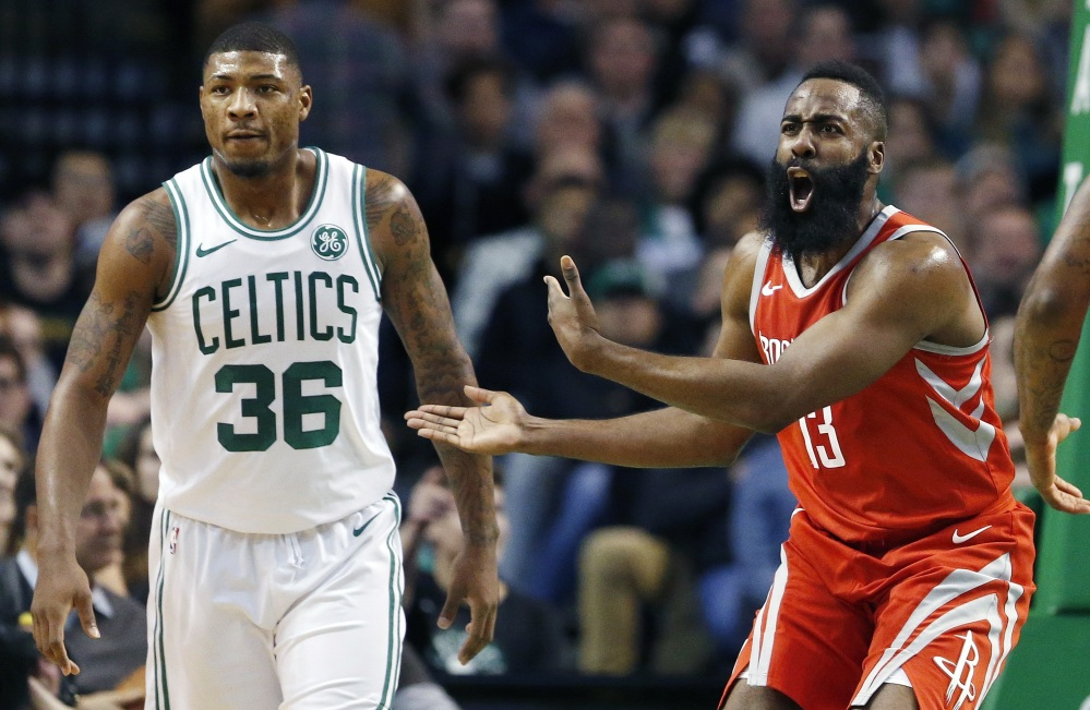 Boston's Marcus Smart, left, draw two offensive foul calls on Houston's James Harden in the closing seconds of the Celtics' win Thursday night.