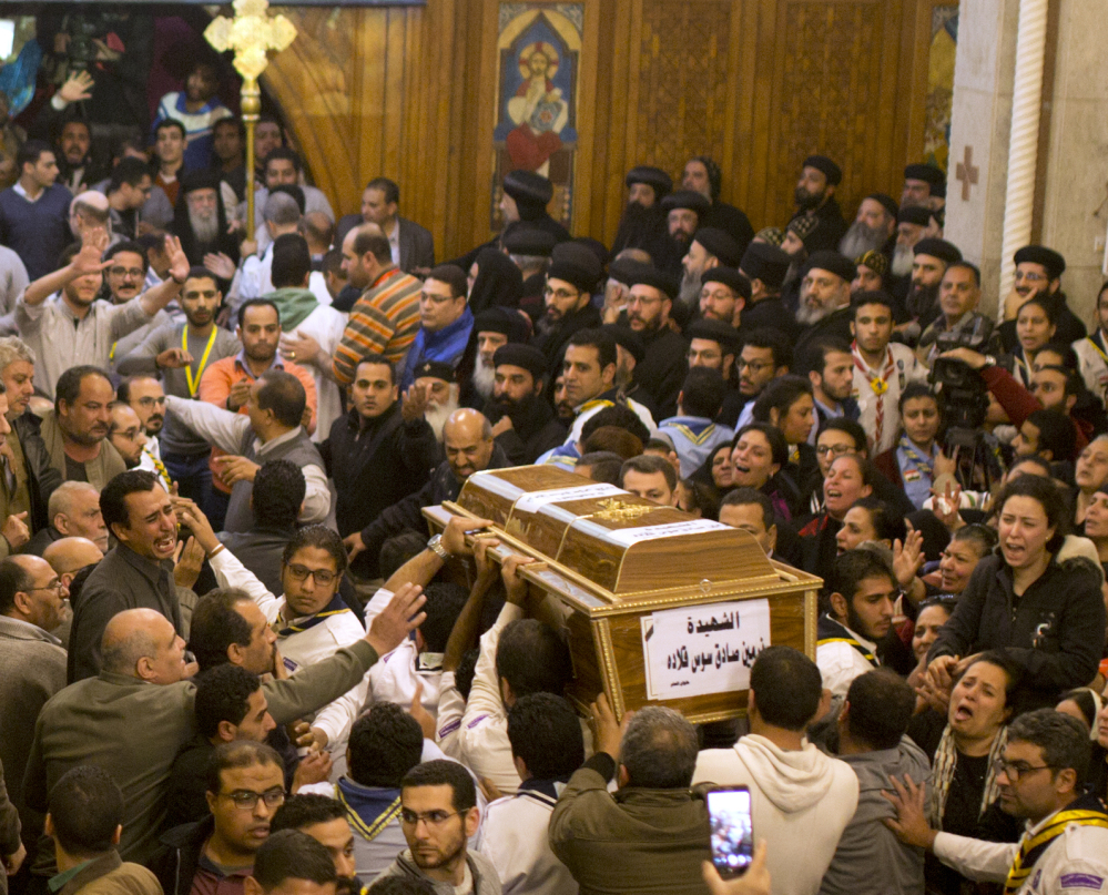 During a funeral service in Cairo, Egypt, Coptic Christians grieve as they carry the coffin of a victim of the attack on Mar Mina church. It was the latest attack aimed at Egypt's Christian minority.