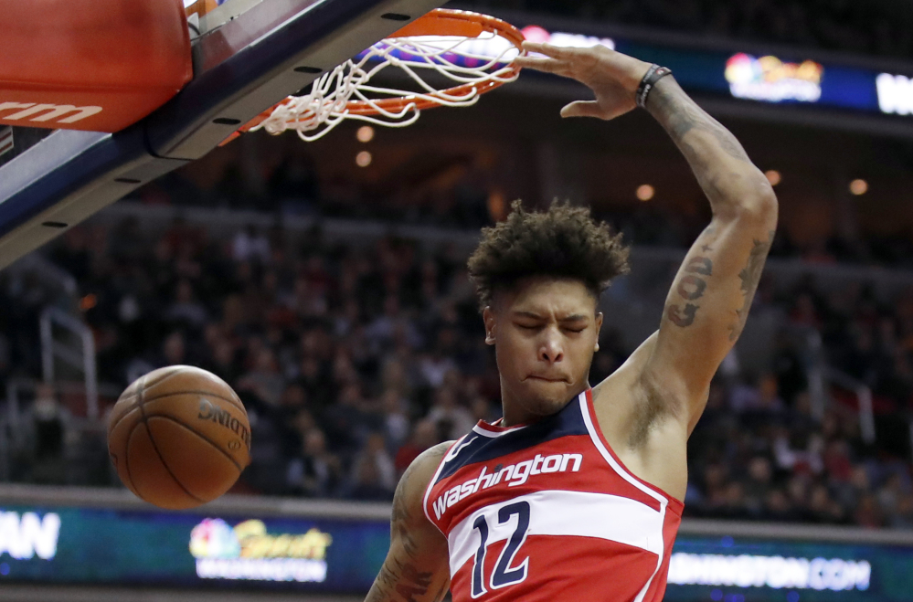 Kelly Oubre Jr. of the Wizards throws down a dunk during a 121-103 win over Houston on Friday in Washington. Oubre scored 21 points and the Wizards handed the Rockets their fifth straight loss.