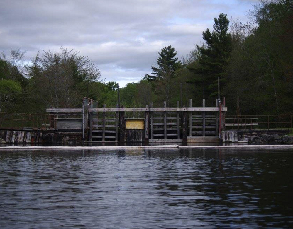 This dam on East Grand Lake straddles the Maine-New Brunswick border at Forest City. Woodland Pulp, which owns it, wants to avoid federal licensing requirements by having the state take ownership of the U.S. side of the structure.
