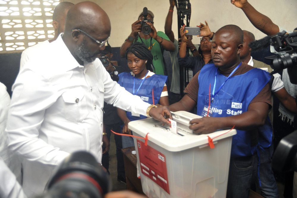 Former soccer star George Weah casts his vote during a presidential runoff election Tuesday in Monrovia, Liberia. He vowed to take on corruption that has dogged the African nation founded by freed American slaves.