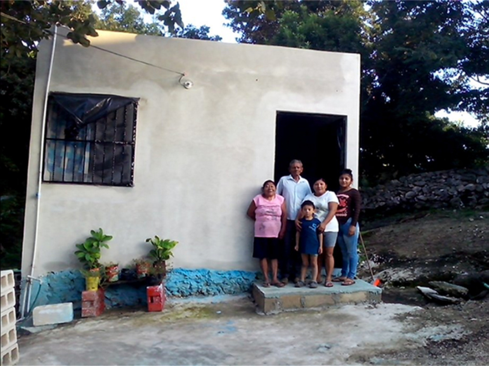 A Wayne couple put forth $8,400 to help the family of Antonia Dzul, second from right, replace a dilapidated home in the Mexican city of Tizimín with the one shown here.