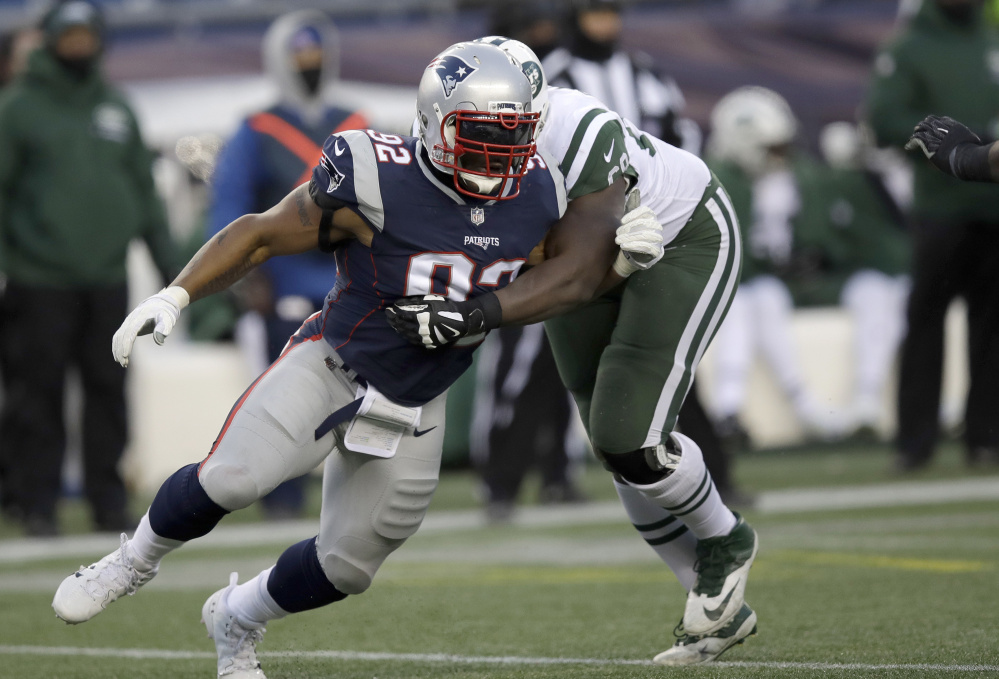 Patriots linebacker James Harrison forces past Jets tackle Kelvin Beachum on his way to a sack in the closing stages of New England's 26-6 victory Sunday.