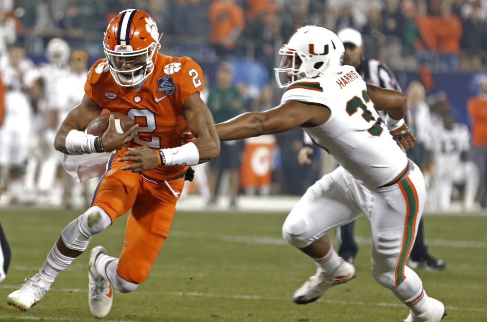 Clemson junior quarterback Kelly Bryant, shown breaking away from Miami's Trent Harris, has established himself as a double-threat for the ACC champion Tigers.